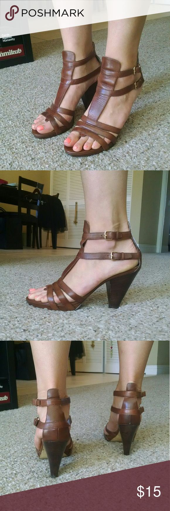 Size 9.5 Brown Strappy Heels - 3in Well worn, but still have life in them! Damage to front of shoes on the underneath Franco Sarto Shoes Heels