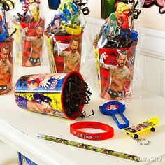 Who says DIY isn't extremely cool? Put together an awesome WWE favor cup by filling it with toys then slip each cup inside clear party bags and tie with ribbon!