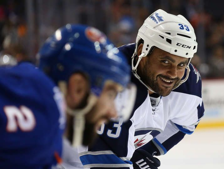 Oct.12 2015 - Wpg 2 - Islanders 4 - Dustin Byfuglien #33 of the Winnipeg Jets speaks to Nick Leddy #2 of the New York Islanders during the third period at the Barclays Center on October 12, 2015 in the Brooklyn borough of New York City. The Islanders defeated the Jets 4-2. (Photo by Bruce Bennett/Getty Images)