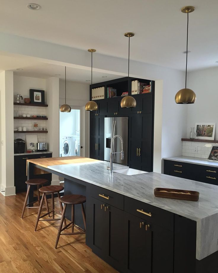 This is our newly renovated kitchen in Decatur, Georgia. The space was designed with elements that remind us of our European travels. The shaker cabinets are a nod to our historic 1925 Craftsman Bungalow. We love the rich dark Farrow and Ball paint combined with local Cherokee Marble from Georgia. Walnut accents were added for a final warming touch to the space. Architect: Kellen Minor email: kcminor@gmail.com