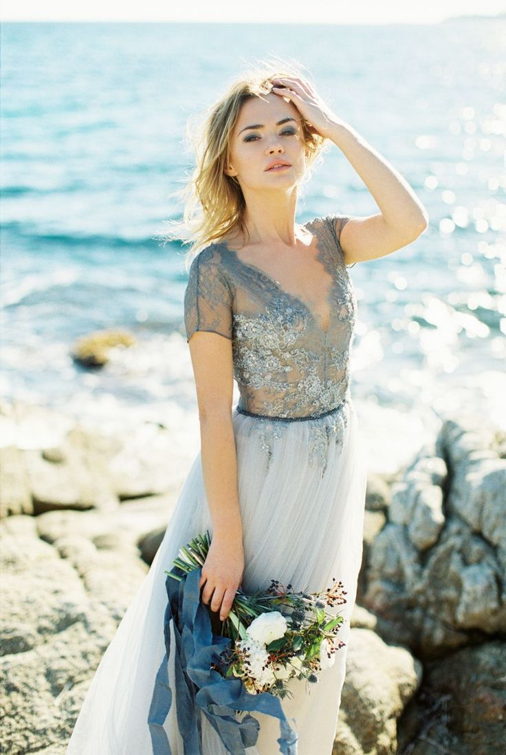Beautifully elegant coastal wedding inspiration from Spain, featuring a blue lace wedding gown and a relaxed casual beach vibe.