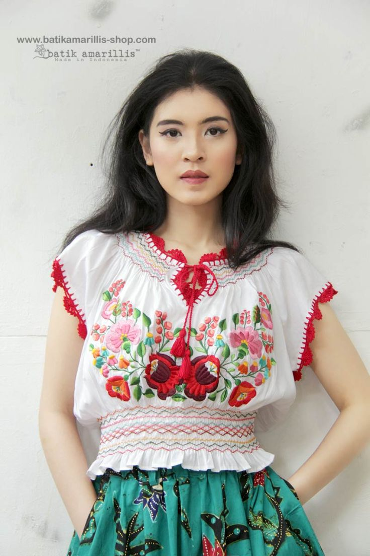 Meet Hajnalka,beautiful & romantic folk inspired blouse with smocking and Hungarian embroidery style,also hand lace knitting The blouse has 7 cm side slit fastening with 2 buttons at one side of the waist #madeinindonesia#hungarianembroidery#folkstyle