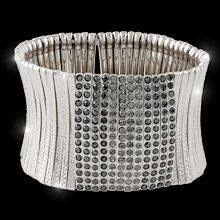 """Screen Goddess Description      Swarovski's black diamond and jet hematite crystals splash the brow of this stunning, expandable bracelet finished in rich rhodium to light up your night and bring style to your daytime life.    6"""" or 7"""" stretch cuff bracelet  Nickel and lead free."""