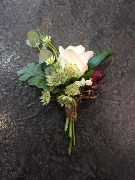 Boutonniere: Silver Leaf, White Lisianthus, Astrantia, tied with twine