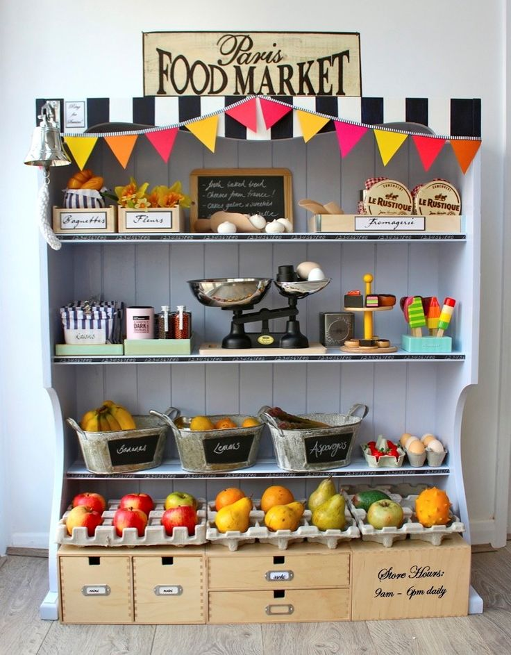 Love the grocery store using the top half off a hutch. The black and white stripe painting, small bunt garland and grocery sign make it look unique.  Would be great to see 'Isabella's Food Market'.