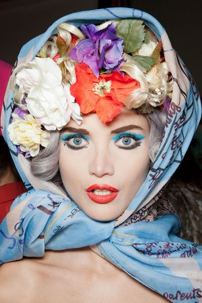 Vivienne Westwood S/S 2013, London Fashion Week. Obviously this is too editorial, but there is a lot of inspiration in this look. Kind of digging the blue liner and the red-orange lip!