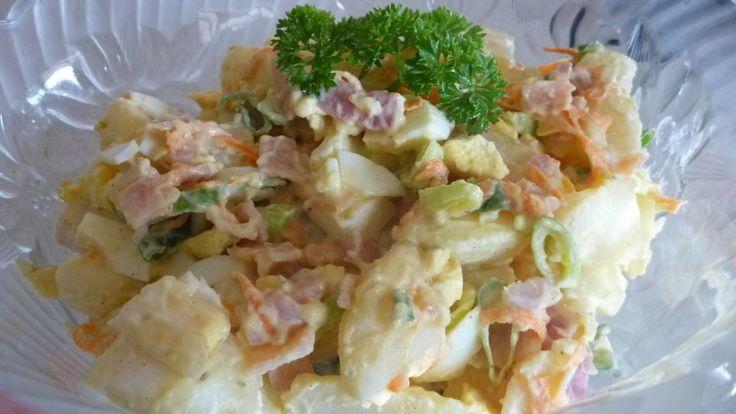 Delicious potato salad made with creamy Caesar salad dressing.