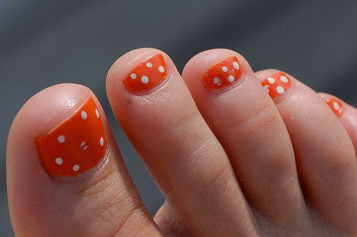 Orange with white polka dots