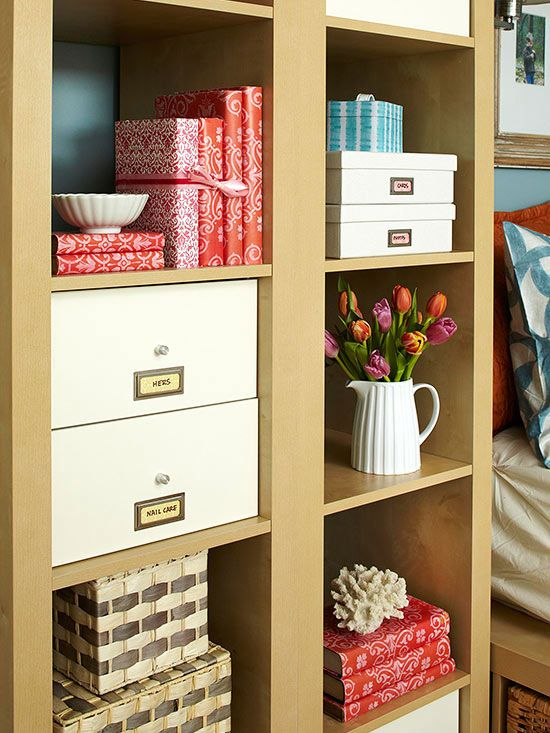 A mix of open and closed storage around the headboard suits different needs. Open cubes display pretty accessories, while doors and drawers conceal utilitarian necessities. /