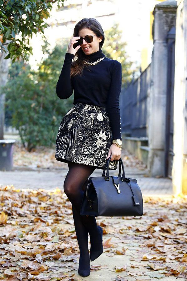 Black turtleneck, chain necklace, black and white pattern skirt and black  leather YSL-bag with black sheer tights and black boots