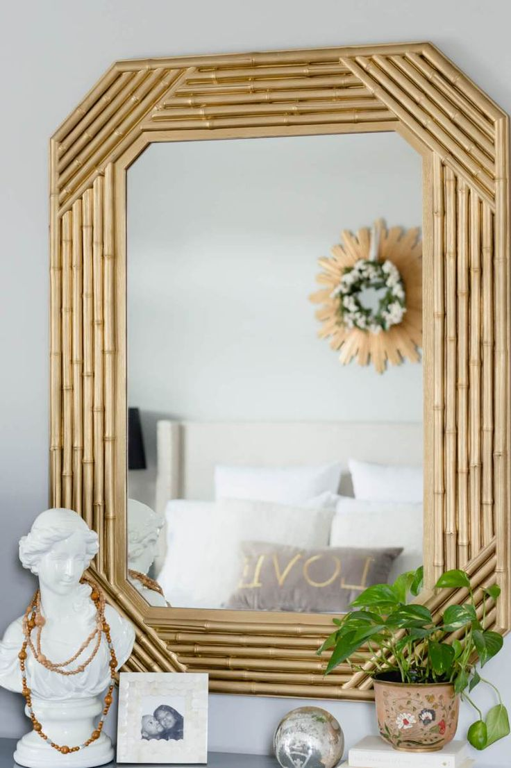 Thrifted faux bamboo mirror makeover with Design Master gold spray paint.