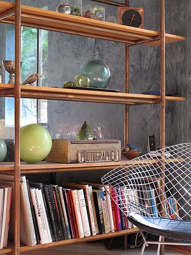 Copper pipes bookshelf by lilithfiend, via Flickr