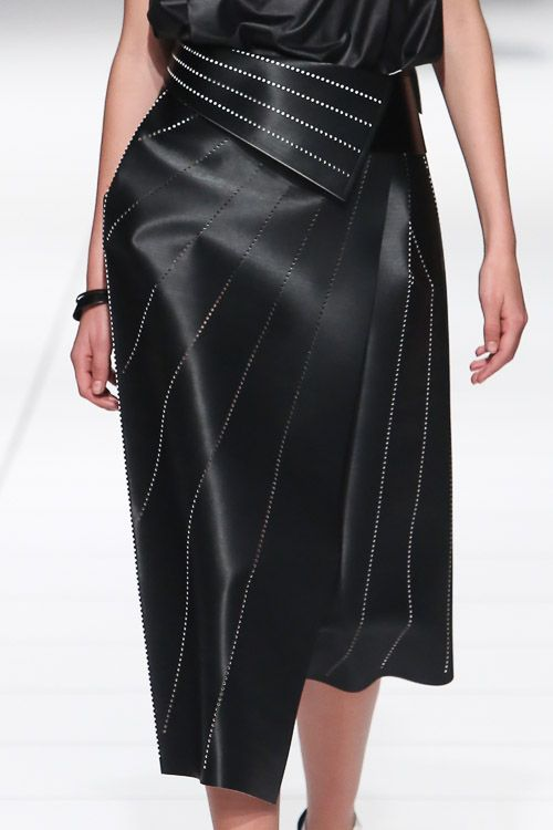 Black wrap skirt with angular cut, perforated patterns & fold over waist; fashion details // Issey Miyake ss14