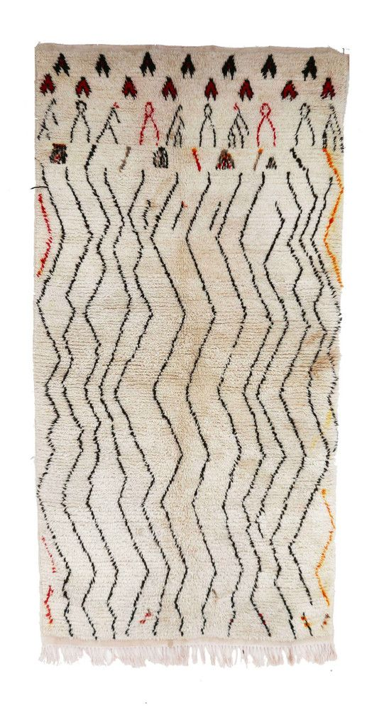 Moroccan Berber rug handwoven by women of the Azilal tribe in the Middle Atlas Mountains. Type of Rug: Azilal Size: 3'5 x 6'11 feet / 103 x 210 cm Material: 100% Wool Age: Vintage / circa 1970s Country of Origin: Morocco Note: The rugs are photographed using daylight. We try our best to have the colors the most accurate as possible. However, please understand that colors may vary on different screens.