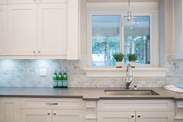 White cabinetry, carrera marble tile backsplash, gray quartz countertops (similar to Urban by Caesarstone).