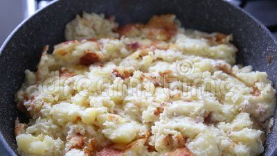 Cheese potatoes in pan - hot steam.
