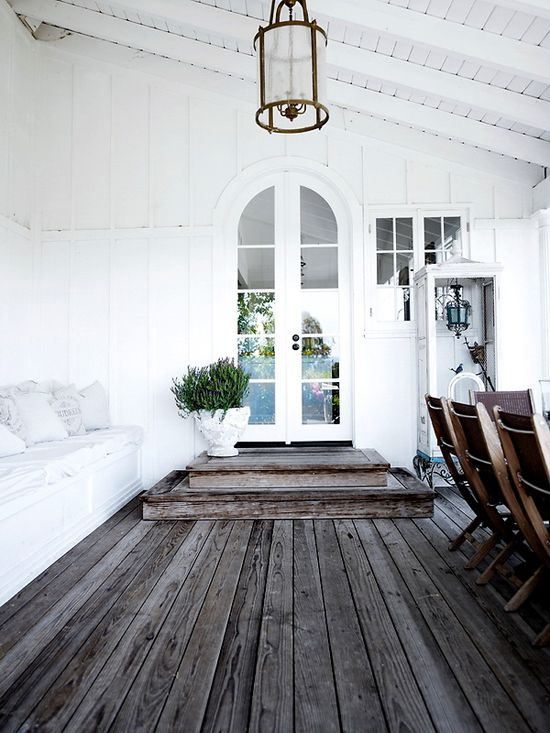 planked white walls & weathered wood floors