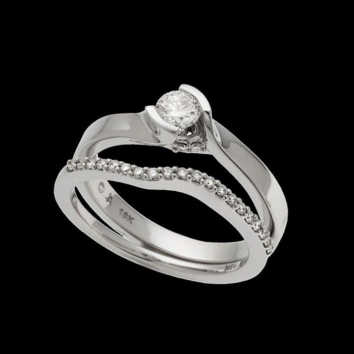 """""""Bella"""" means beautiful in Italian, and this ring lives up to its name. This ring has a 0.25 carat round brilliant center diamond."""