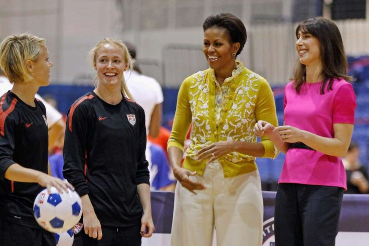 President Barack Obama and his soccer connection:    First Lady Michelle Obama and Samantha Cameron, wife of U.K. Prime Minister David Cameron, visit with U.S. women's national team midfielder Lori Lindsey and defender Becky Sauerbrunn during a tour of an Olympics‐themed event with area school children at American University on March 13, 2012.