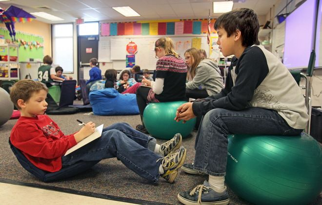 """Some schools giving desks the boot"" Article form Pulitzer Prize winning Milwaukee online journal, JS.Online... providing a few yoga balls for kids to sit on and move up and down a bit could be just the thing to keep active learners busy enough to focus on what they are working on..."