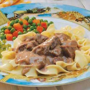 Beef in Onion Gravy  This is great over mashed potatoes.   1 can cream of mushroom  2T onion soup mix  1 lb beef stew meat  2 T beef broth  Combine all ingredients and cook on low 6-8 hours.  Serve over noodles or potatoes.