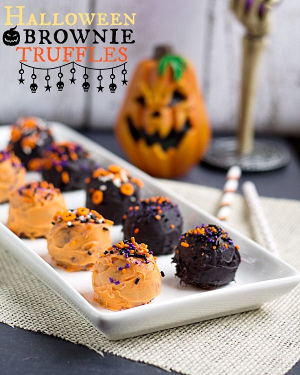 Halloween Brownie Truffles Recipe ~ dipped in vanilla candy melts and topped with fun, spooky sprinkles
