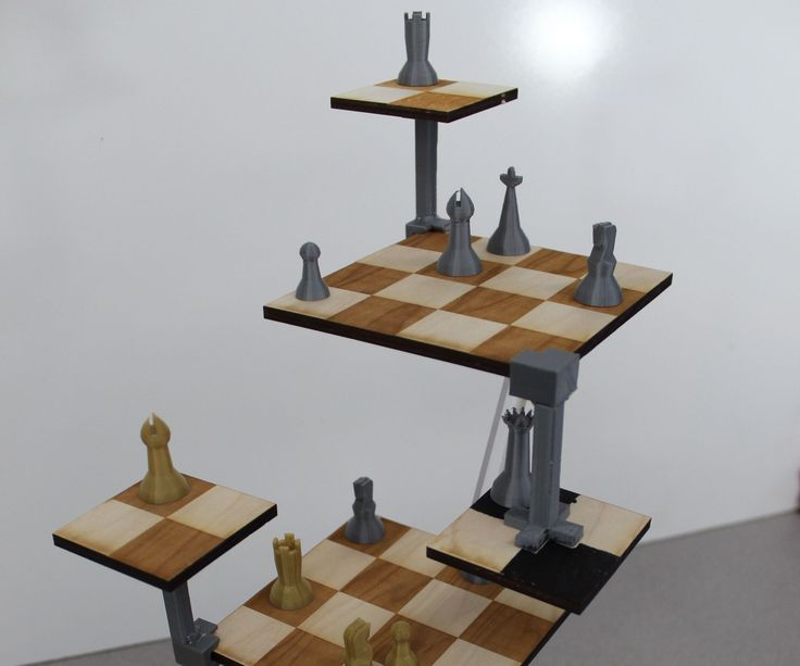 """For my SIDE Project, I decided to make a Three Dimensional Chess Set, just like the kind that Kirk and Spock famously play in Star Trek: The Original Series. 3D Chess is played just like traditional chess, but with the added third dimension to promote """"spatial thinking."""" Pieces cannot easily transition between the three large main boards, however. Smaller boards that can be placed above or hung along the corners of the main represent """"starships"""" that must act as a bridge ..."""