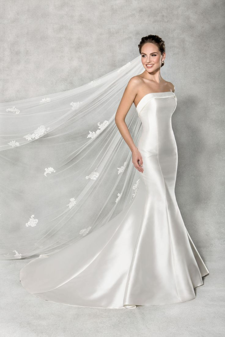 This stunning fishtail wedding dress is a dream. Luxurious mikado sculpts every curve, with delicate buttons down the back