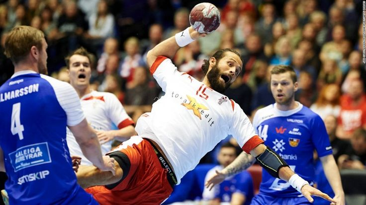 danish handball player prepares to throw the ball against iceland