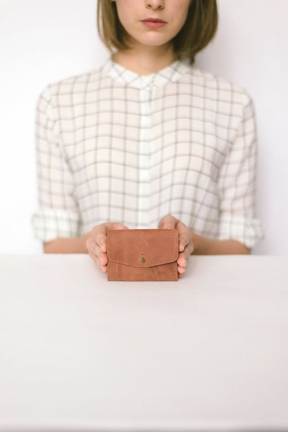 Leather Wallet is made of high-quality matte brown leather. Simple, minimalist and functional design of leather wallet suitable for both men and women. Designed with a single main compartment for cash, additional compartments for credit cards and a simple stud fastening. When folded, it is very small and fits in your pocket or clutch.  9,5*7,5 cm / approx. 4 * 3 inch