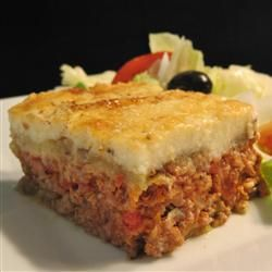 "Moussaka | ""Here is a great recipe for moussaka, a Greek dish. It includes sliced eggplant baked in a ground beef sauce and then smothered in a thin white sauce."""