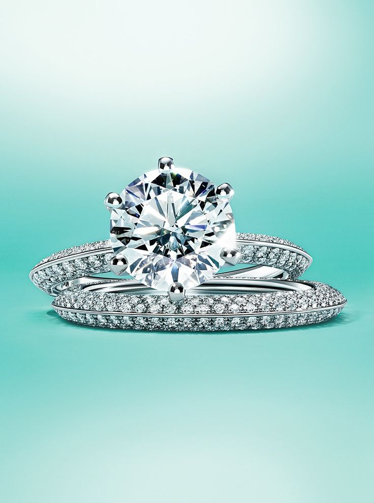 The Pavé Tiffany® Setting engagement ring and Tiffany® Setting band ring in platinum.