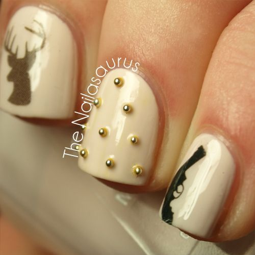 This would be cute like with the deer on one nail on each h hand and the rest French manicure