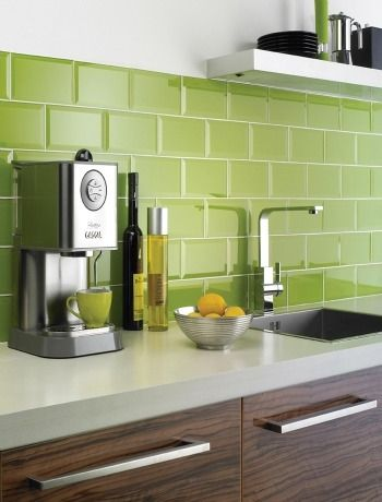 Green subway tile w/ wood cabinet & white countertop