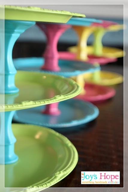 inexpensive two-tiered food display trays - made with spray painted dollar store silver trays and crystal candle sticks.