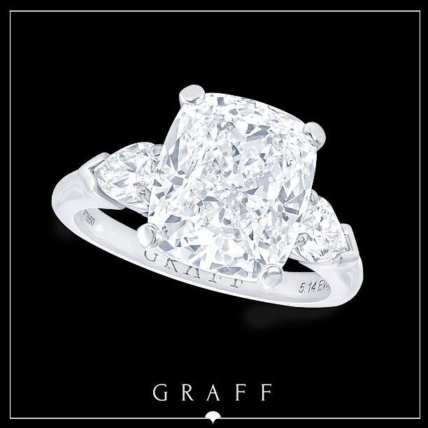 A 5.14ct Cushion Cut Diamond with Pearshape Diamond Shoulders.  #graffdiamonds #graff #bridal #wedding #engagement #ring
