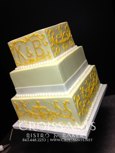 traditional wedding cake with yellow design by Croissants Bistro ...