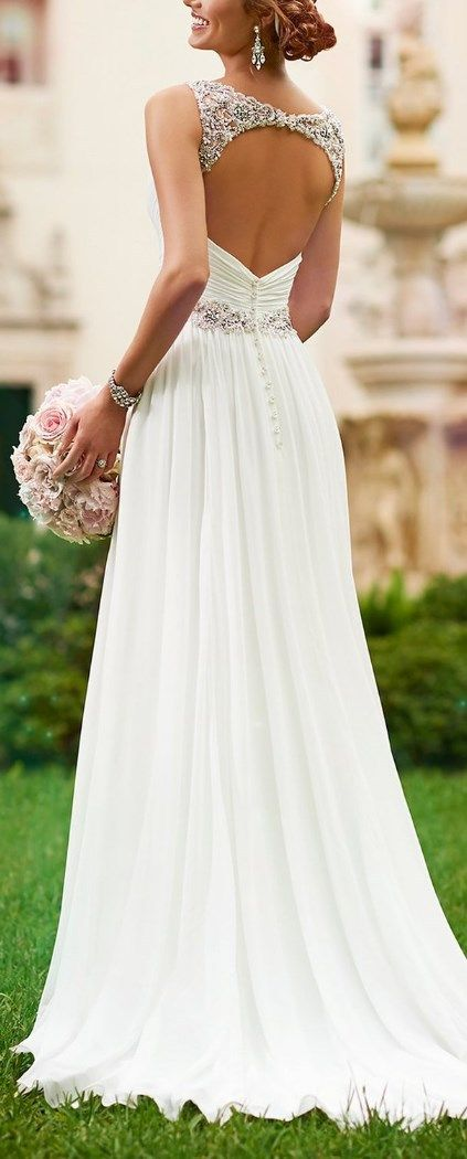 You'll look classic and divine in this sheath Chiffon wedding dress. This wedding gown highlights fine Diamante detailing on its waist, shoulder straps, and in the keyhole head-turning back. The back zips up supporting sparkling crystal buttons and the adapted bodice boasts soft ruching. It's the perfect wedding dress you need for a little price and a great look! http://www.cutedresses.co/product/v-neck-shoulder-straps-soft-ruching-chiffon-wedding-gown/