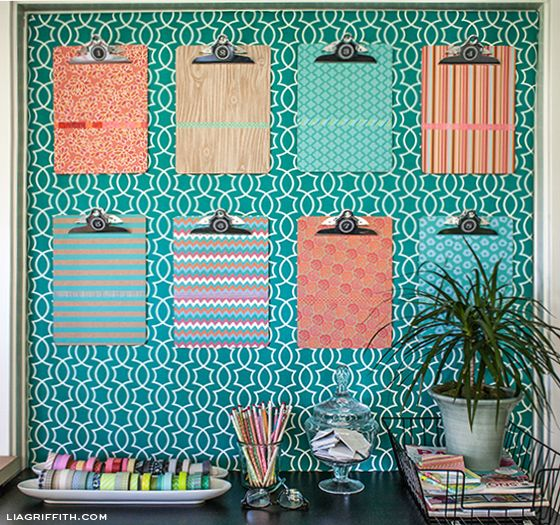 Above the desk? Either that or a large pinboard.  Style Your Clipboards with Printed Label Paper and Washi Tape