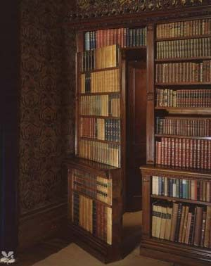 Secret bookcase door with dummy books in library of Oxford Hall