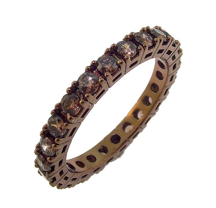 anello marrone con zirconi marroni