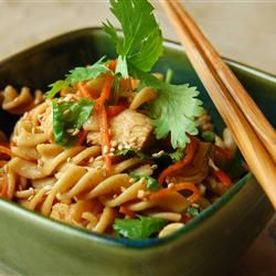 Sesame Pasta Chicken Salad. This was amazing. I made the sauce while the bow tie was cooking. I drained the noodles and poured them into the sauce warm. It soaked up all the sauce! Also included carrots, celery, purple cabbage, cilantro and purple onion. Delish!