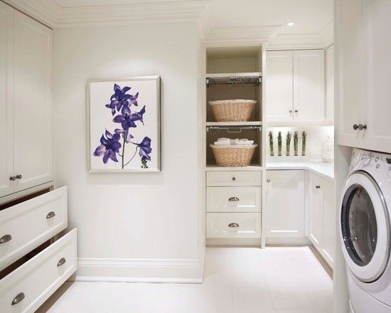 Simplicity, great storage, clean lines. Beautiful laundry room.