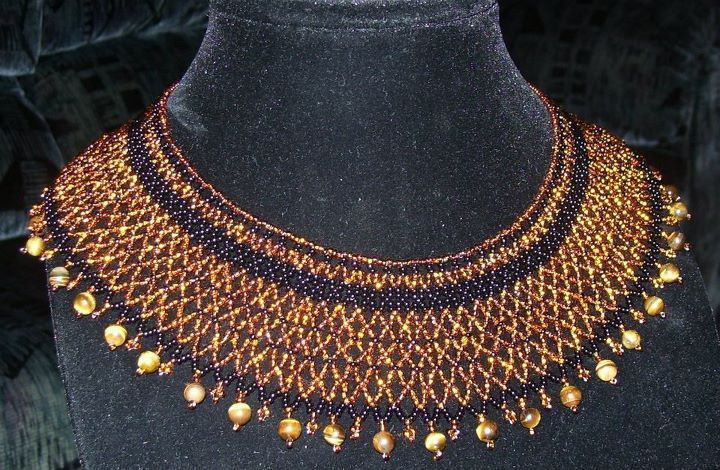 Bead netted collar made using glass size 10 beads with a tiger eye stone border.    www.facebook.com/teristreasures