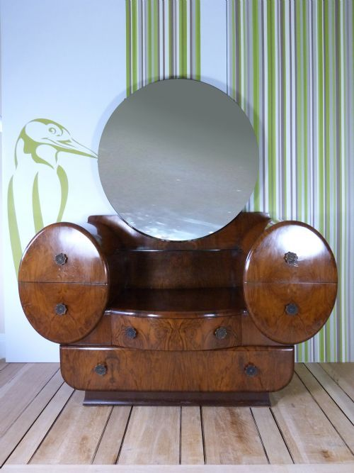 A Stunning Art Deco dressing table with a large central circular mirror. Two drawers either side of the lowered middle section.