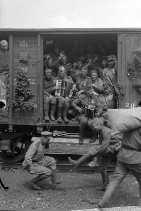 Returning home: Red Army soldiers have a round of dancing as they prepare to depart for home. It is obvious that transportation comfort was a low priority. But few really cared. They had survived the worst war in history.