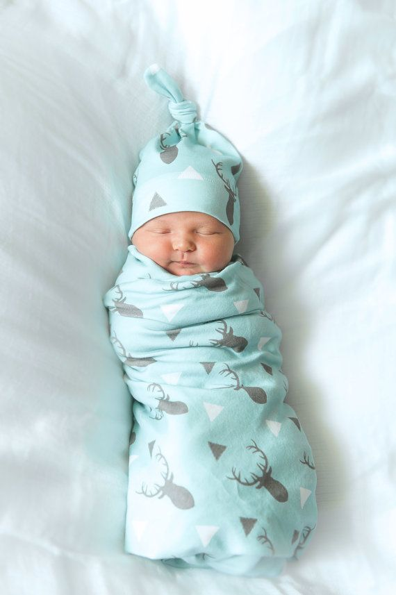 Organic Baby Swaddle with Matching Newborn Knot Hat<-----<<<     SWADDLE>>>>>  > Measures 35x 35 > Swaddling is proven to calm and sooth babies  > Wrap baby or use to cover up when nursing  > Surged hem with stretch thread and rounded corners  > Modern and trendy deer print designed by Googoodoll    KNOT HAT>>>>>  > Size~ Newborn or 0-3 Months  > Top knot style can be adjusted as needed > Helps newborn maintain body heat  > Perfect newborn photo prop   LEGGINGS>>>>>  > Newborn~ up to 12 lbs…