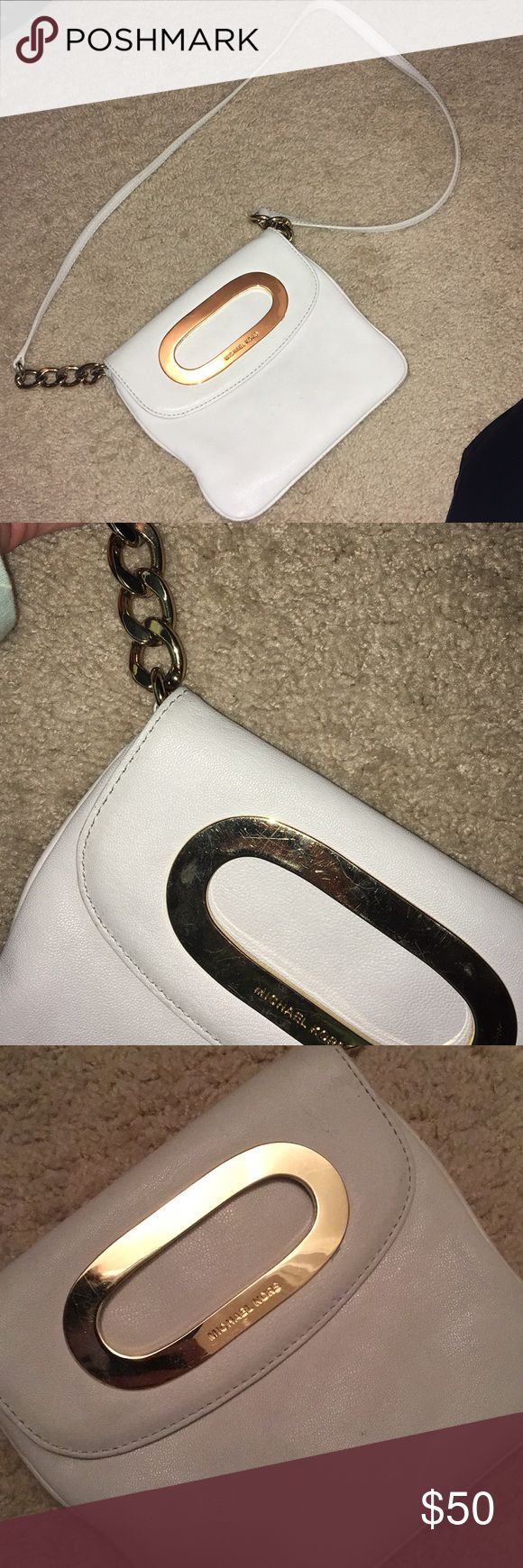 White Cross Body Michael Kors Purse Michael Kors purse. A few scratches on front buckle, inside in perfect condition. Has gold chain accents KORS Michael Kors Bags