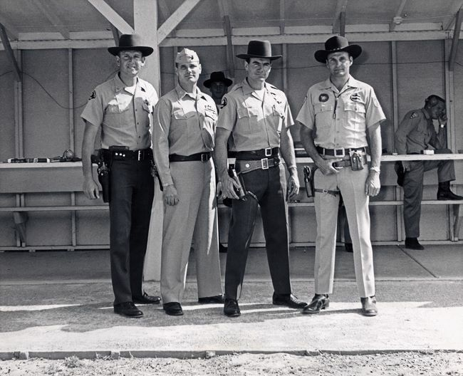 San Diego Sheriffs Department shooting event, 1964. From L-R: San Diego Sheriff's Deputy Leon Hoffman, USMC Captain William McMillan, San Diego Sheriff's Deputy Elden Carl and Ray Chapman.