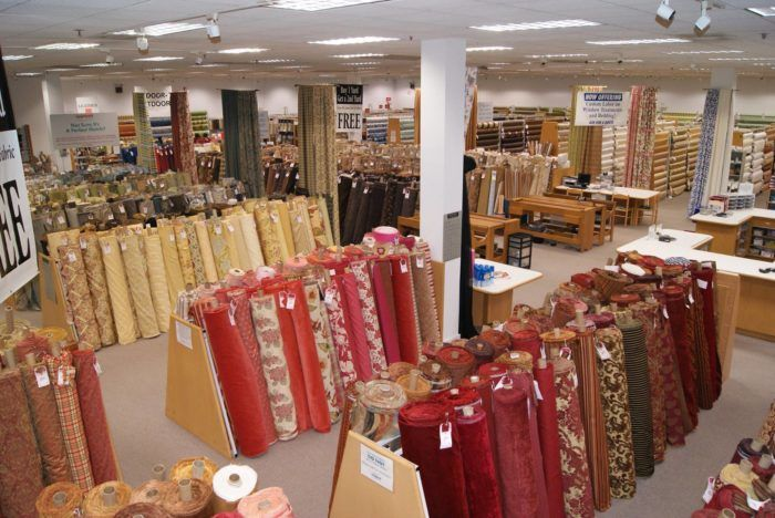 The Massive Fabric Warehouse In Illinois Loomcraft Fabric Outlet Is A Crafter S Dream Come True Fabric Outlet Fabric Store Displays Fabric Store